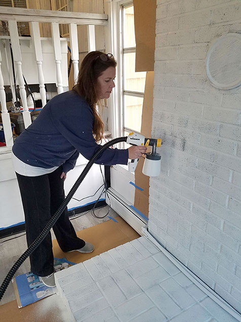 priming-and-painting-a-brick-fireplace-the-easy-way