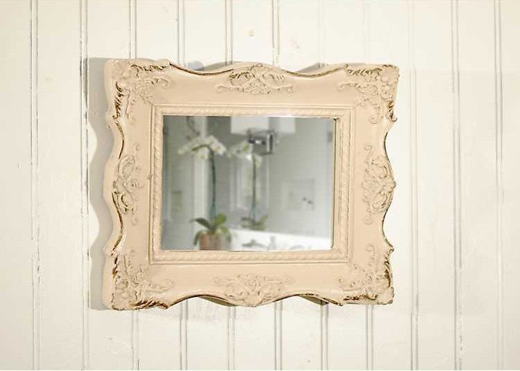 small white mirror with ornate frame