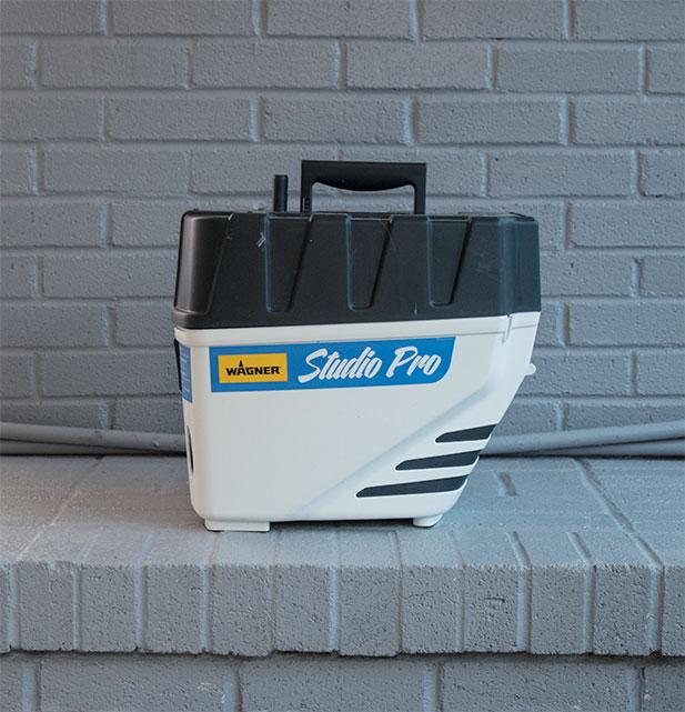 using-a-paint-sprayer-to-cover-bricks