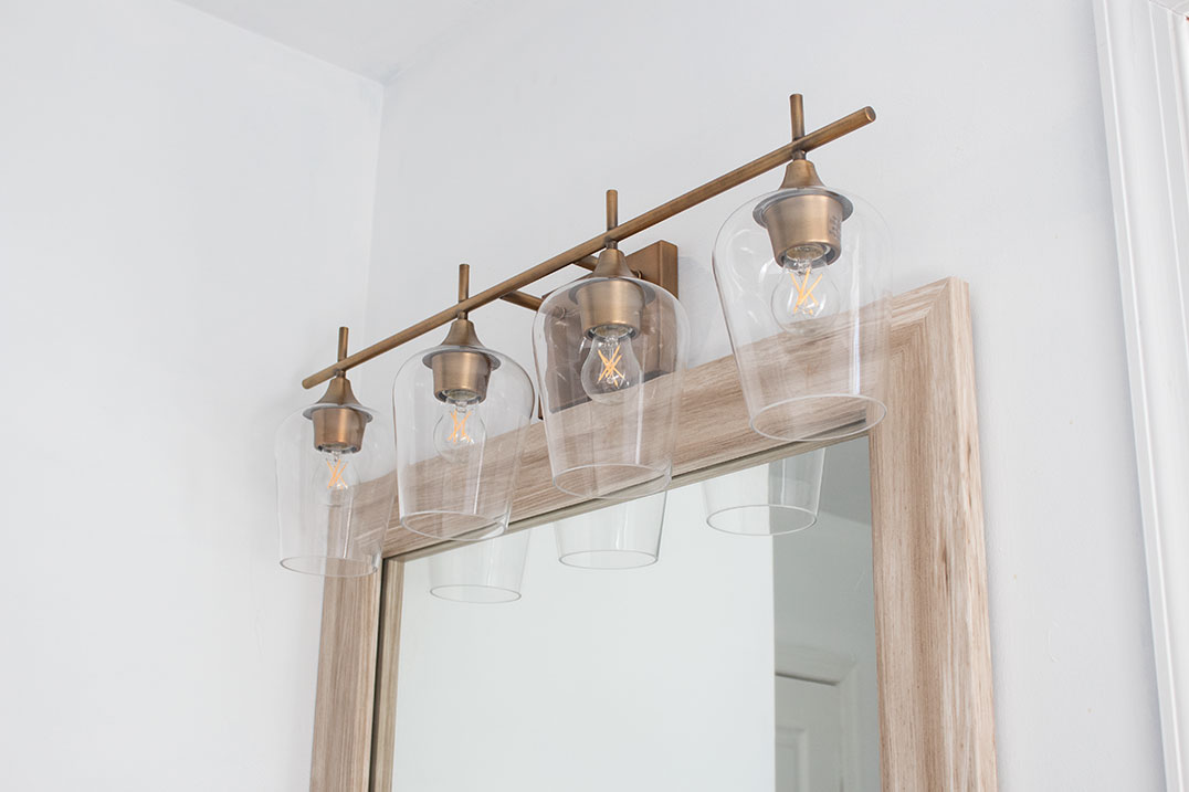 antiqued-brass-bathroom-vanity-light-fixture
