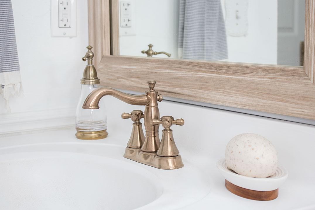 antiqued-gold-delta-faucet-bathroom