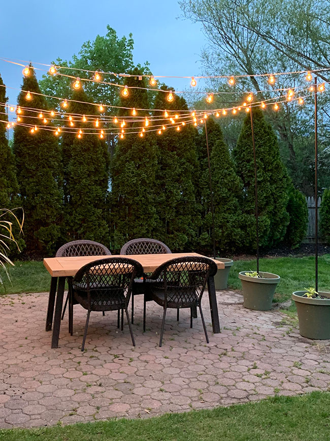arbor of string lights over the patio, garden ideas