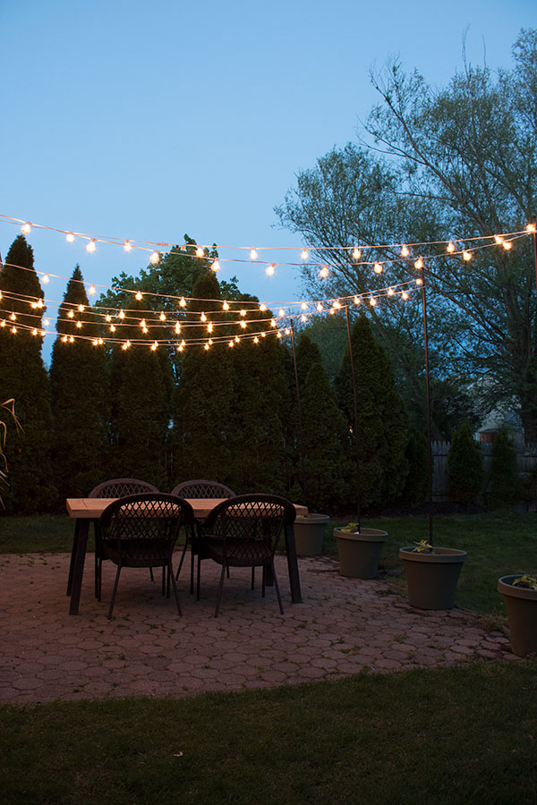 how-to-create-a-canopy-of-string-lights-over-your-patio-or-deck