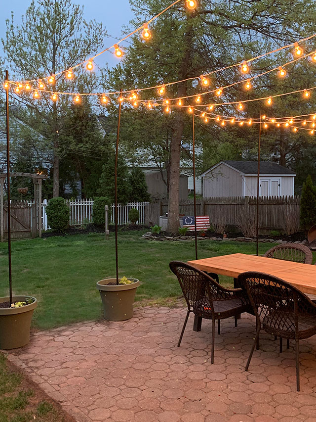 DIY Patio Arbor Using String Lights - The Honeycomb Home