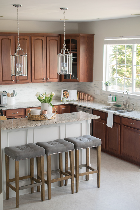How to choose kitchen counterrtops - these are granite with wood cabinets.