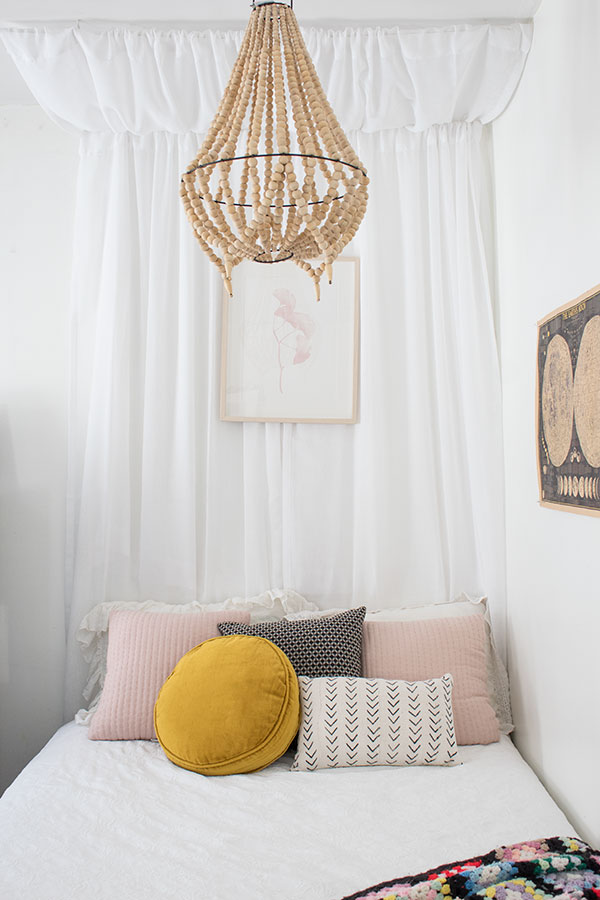 how to hang a canopy using curtains over the bed