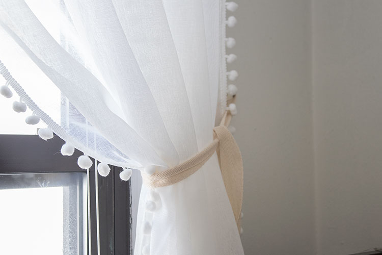 white-sheer-curtains-with-pom-poms-home-decor