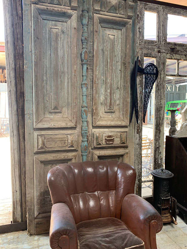 large rustic door with spindles