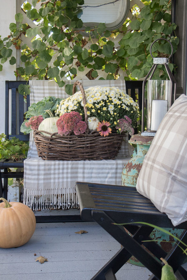small front porch decorating ideas for fall with mirror and basket full of mums