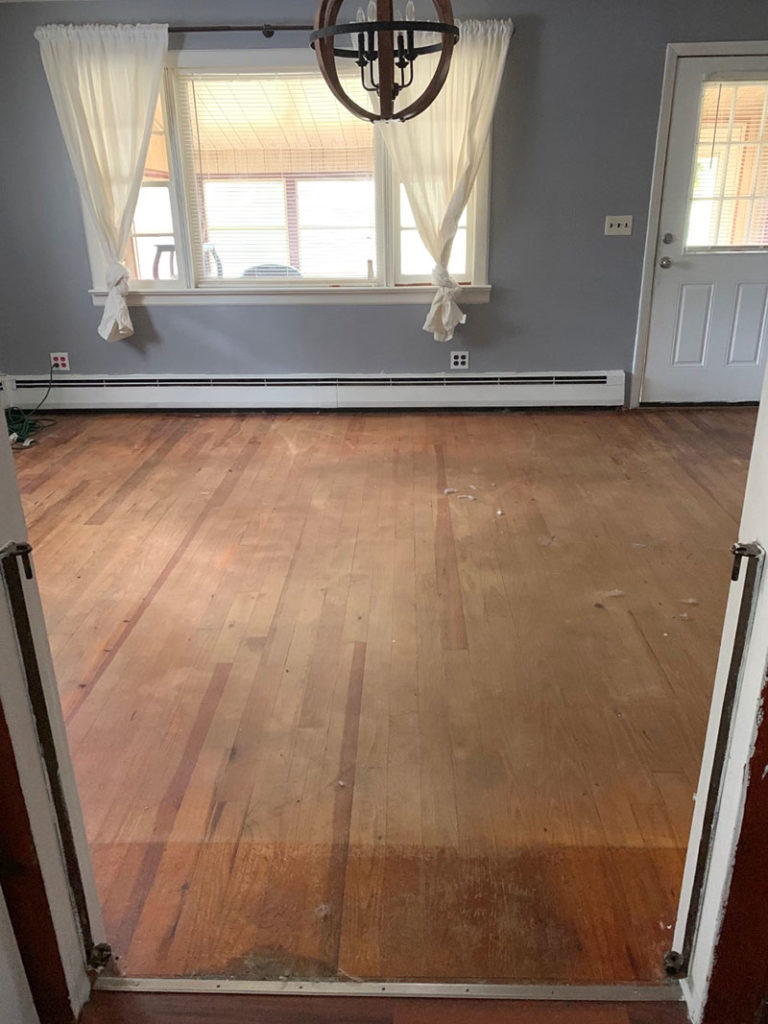 a how to guide for wood floor refinishing, we gave them a white wood flooring look after sanding
