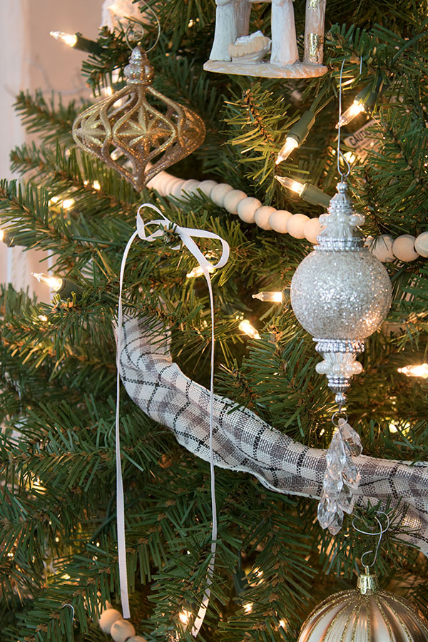 Vintage ornaments displayed on a cozy, country cottage Christmas tree