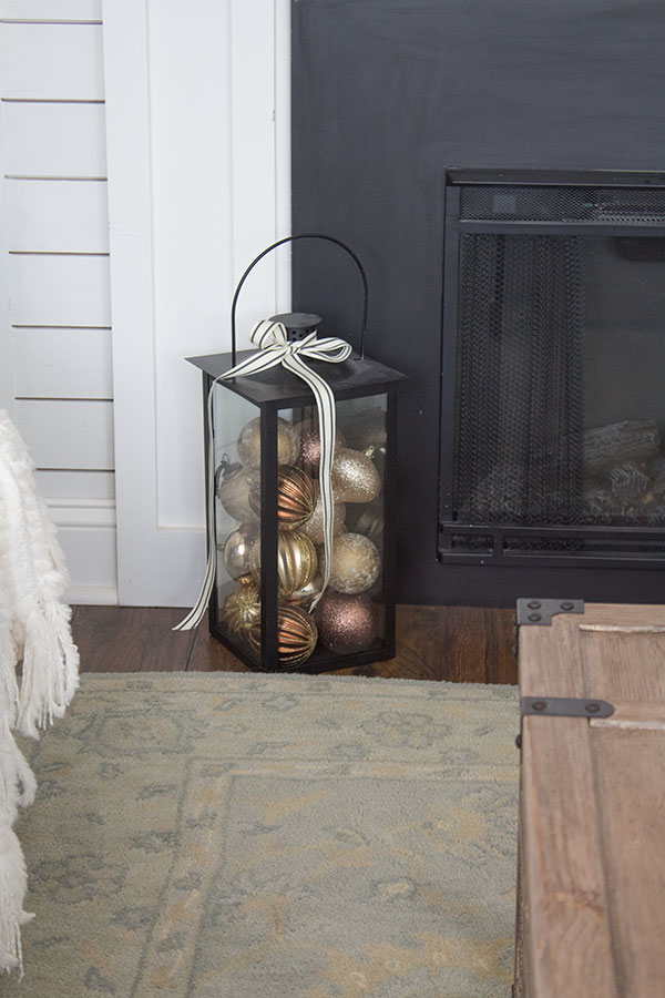 Decor accessory lantern filled with ornaments for the holidays