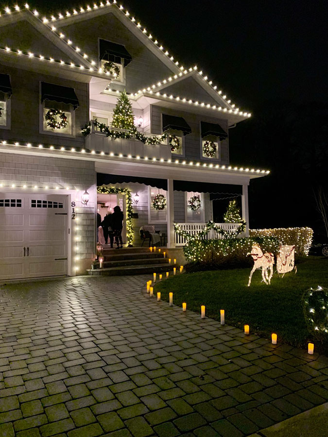 All white Christmas lights on house exterior, tour the rest of this holiday showhouse for more decorating ideas!