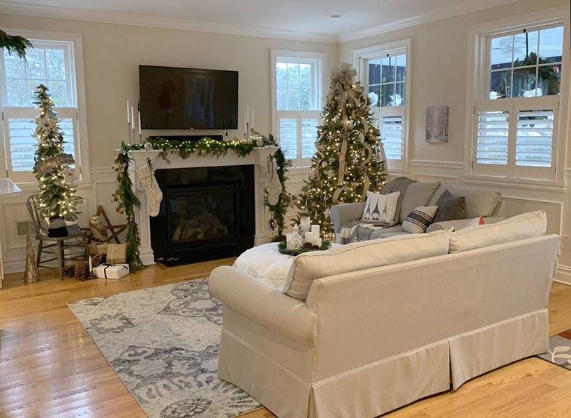 Decorating with Christmas lights and Christmas decorating ideas.  Living room with 2 trees.