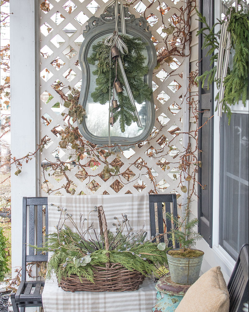Outdoor mirror on porch, winter decorating exterior.