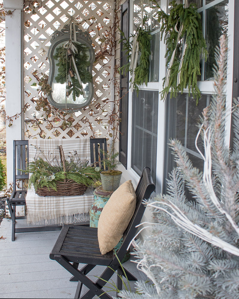 Beautiful small front porch decorating ideas on a budget!  Love the all natural elements.