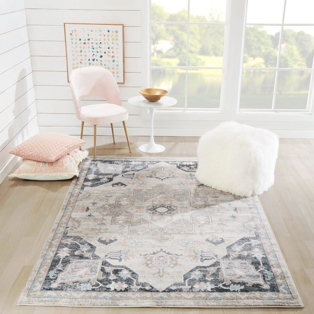 A pretty area rug can instantly brighten up even the dullest of living spaces