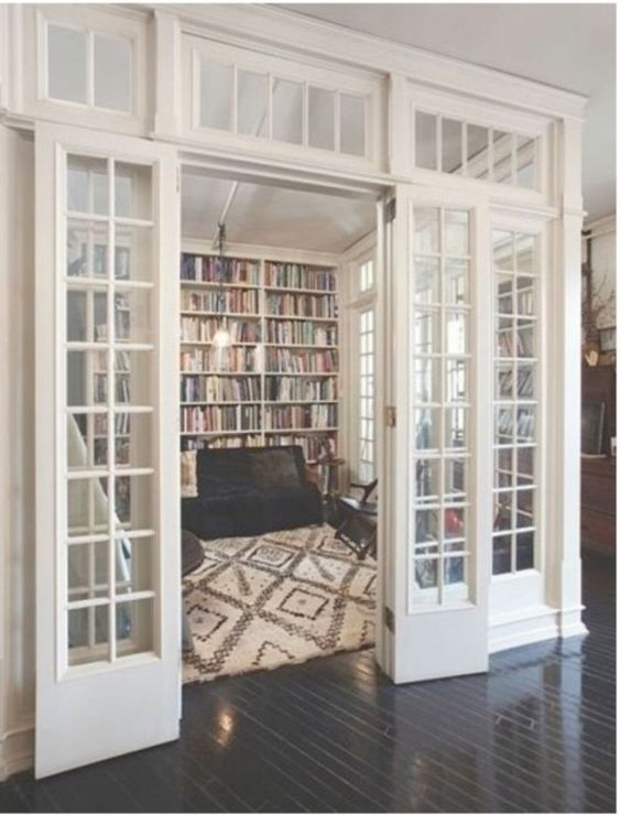 floor to ceiling bookshelves in living room