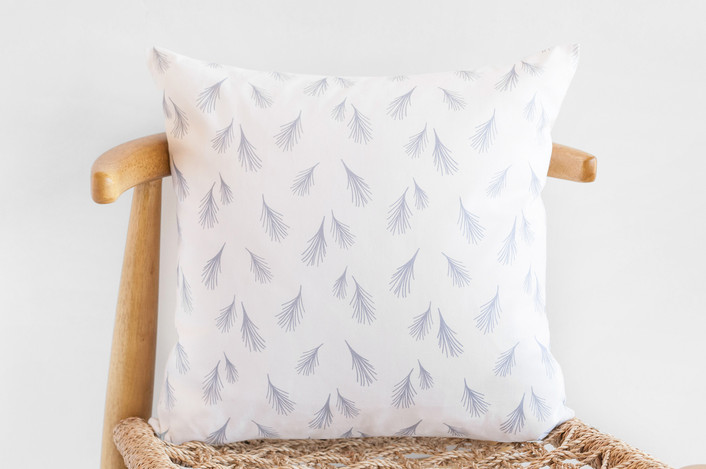 neutral throw pillow with small scale pattern
