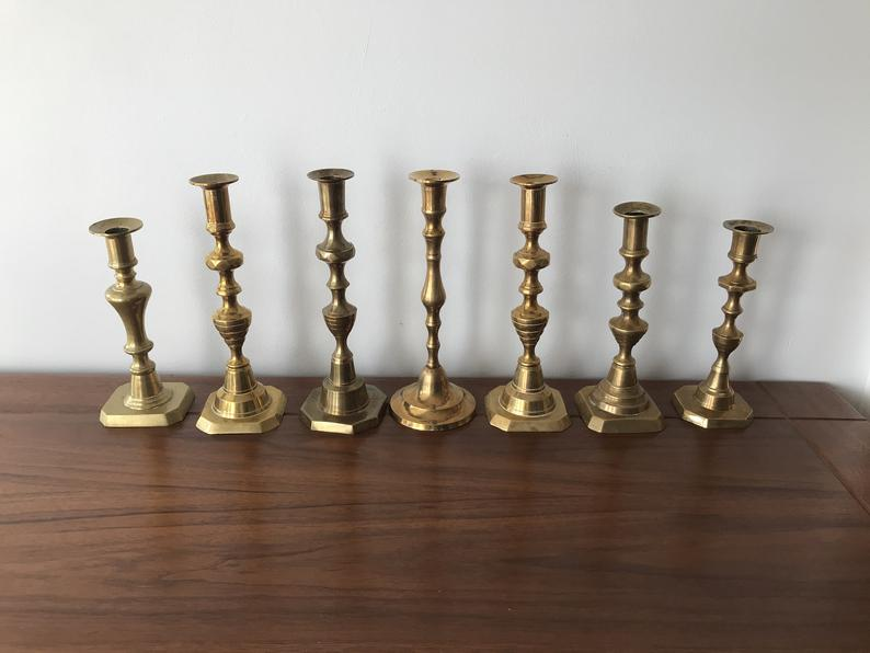set of 7 vintage brass candleholders