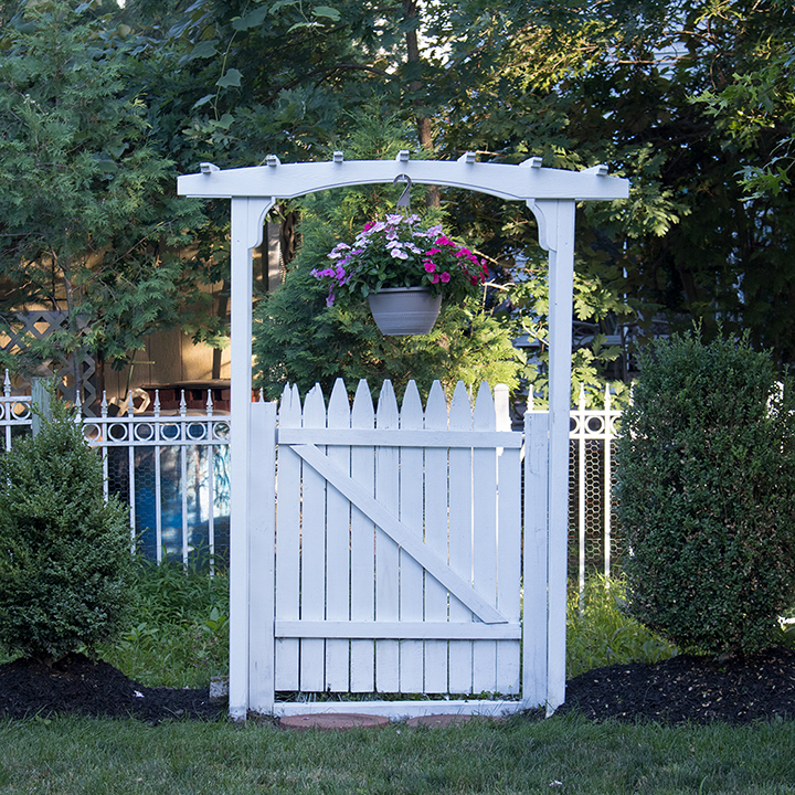 how to paint a garden arbor with a gate