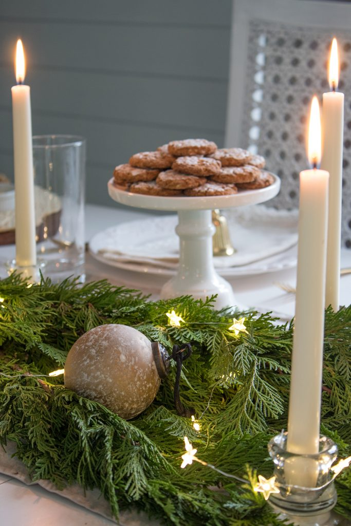 Christmas serving stand and table with fresh garland