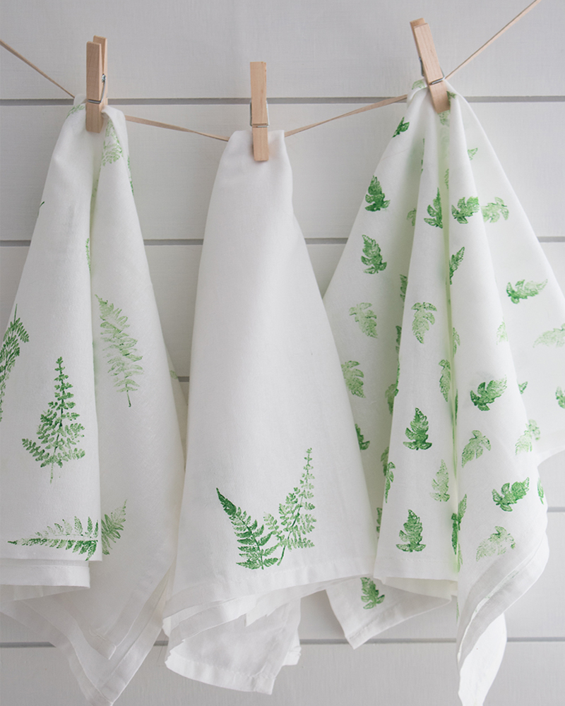 how to make stamped fabric tea towels with a fern pattern.