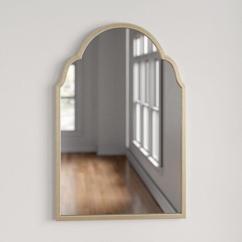 arched brass mirror