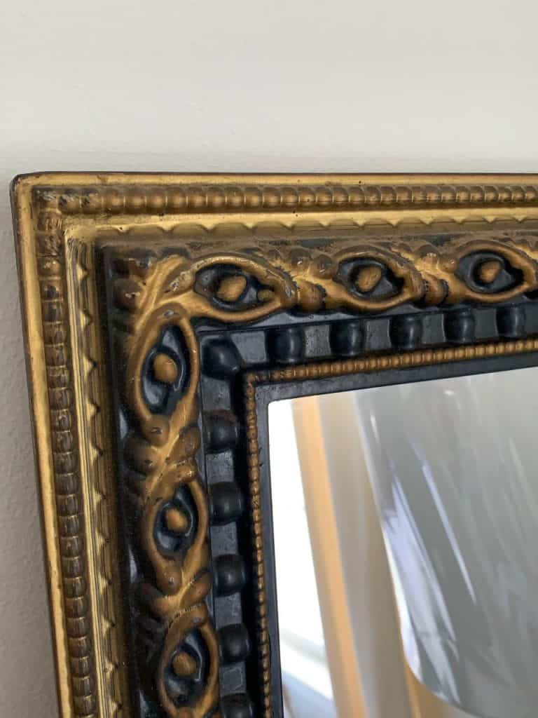 gold and black ornate mirror