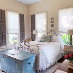 Bedroon-with-interior-shutters-and-vintage-trunk