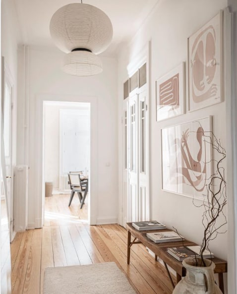 hallway with wood floors and white walls