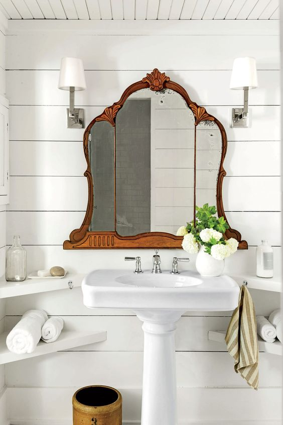 small cottage bathroom with vintage mirror