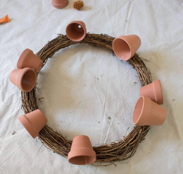 wreath with mini terracotta pots